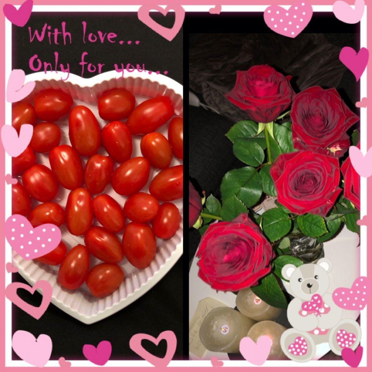 Tomater i hjärtformad ask och röda rosor